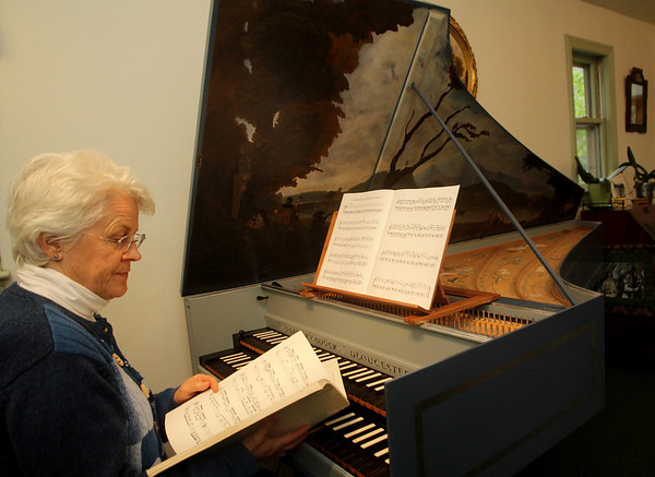 ALLEGRA BOVERMAN/Staff photo. Gloucester Daily Times. Gloucester: Frances Fitch at the harpsichord built by her husband Greg Bover.