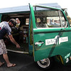 ALLEGRA BOVERMAN/Staff photo. Gloucester Daily Times. Gloucester: T.J Peckham of Gloucester, head of sales for Cape Ann Brewing Co., vacuums out his 1978 Volkswagen camper at Cape Ann Car Wash on Friday morning. He and his vehicle have been traveling the northeast over the last three weeks and it just had to be cleaned inside and out.