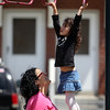 ALLEGRA BOVERMAN/Staff photo. Gloucester Daily Times. Gloucester: Allison Hammond of Gloucester playing with her daughter Lizzy Harrison, 4 1/2, after preschool on Friday afternoon.