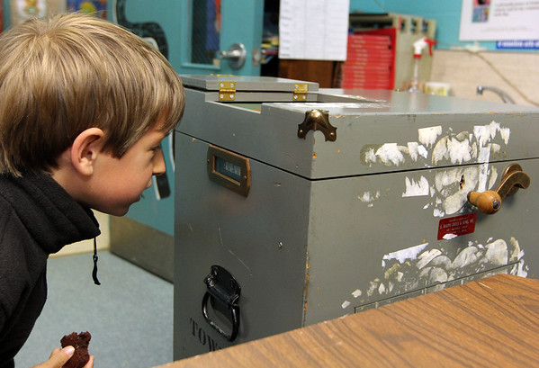 ALLEGRA BOVERMAN/Staff photo. Gloucester Daily Times. Rockport: Daniel Merz, 7, checks the ballot box tally during elections at Precinct Three at Rockport Elementary School on Tuesday. At about 3 p.m. there were more than 500 votes cast at that location.