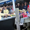 ALLEGRA BOVERMAN/Staff photo. Gloucester Daily Times. ROCKPORT: Sandy Lee breaks champagne over the bow of the fishing vessel Ocean Reporter on Friday afternoon during a denaming and renaming ceremony of the boat held at the Sandy Bay Yacht Club at Sandy Bay Harbor.