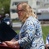 ALLEGRA BOVERMAN/Staff photo. Gloucester Daily Times. Gloucester:  Gloucester Mayor Carolyn Kirk proclaimed Thursday a special day in honor of retiring Gloucester High School Principal William Goodwin seated at right. A surprise tribute to him was held at Newell Stadium by the entire school population.