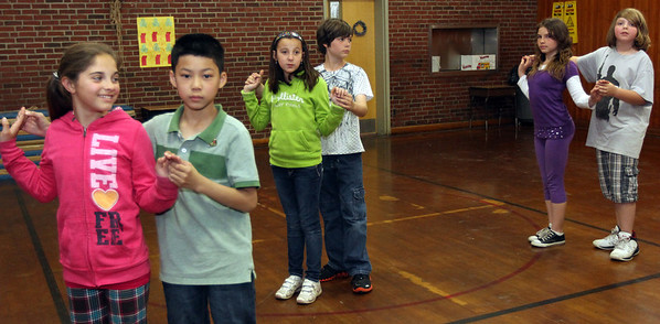 ALLEGRA BOVERMAN/Staff photo. Gloucester Daily Times. Gloucester: Veterans Memorial Elementary School fifth graders from left: Zariah Billante, Jack Ho, Piera LoContro, Zachary Pepin, Margaret Clary, and Steven Brown rehearse their ballroom dancing moves for the upcoming seventh annual Mad Hot Ball to be held on Sunday at the Gloucester High School Field House from 2-4:30 p.m. Three hundred fifth graders from across the school district will be participating and have been preparing for this for several months.