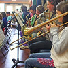 Forth-grader Alanna Fitzgerald plays the trombone Tuesday afternoon at band practice at Essex Elementary School in preparation for the regional elementary spring concert that evening. Jesse Poole/Gloucester Daily Times May 1, 2012