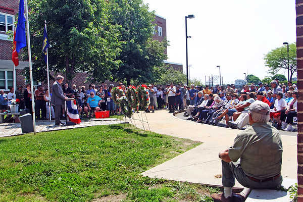 Jesse Poole/Gloucester Daily Times May 28, 2012 GLOUCESTER— The audience listens as Mark Nestor, local attorney and Vietnam War Veteran, reads the names of the Gloucester soldiers lost during the Vietnam War. This ceremony, commemorating the 50th anniversary of the Vietnam War took place outside Gloucester High School on Monday morning after the city's Memorial Day parade and ceremony.