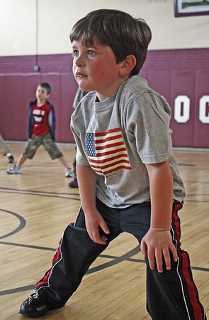 Jesse Poole/Gloucester Daily Times May 15, 2012 GLOUCESTER— Kindergartener Jake Timmons stretches in the gym at Rockport Elementary School before going out to the track for running club on Tuesday morning before school started.