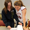 ALLEGRA BOVERMAN/Staff photo. Gloucester Daily Times. Gloucester: Audrey Knowlton, left, a Gloucester High School senior, signed her letter of intent to play basketball for New York Institute of Technology on Wednesday afternoon. Fellow senior Hayley Labrecque, right, looks at the school's document with her.