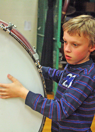 Joshua Dobson, fourth grader at Essex Elementary School, plays a rather large drum Tuesday afternoon, practicing with the rest of the band for the regional elementary spring concert that night. Jesse Poole/Gloucester Daily Time May 1, 2012