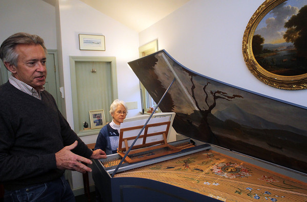 ALLEGRA BOVERMAN/Staff photo. Gloucester Daily Times. Gloucester: Frances Fitch and her husband Greg Bover at the harpsichord he built for her.