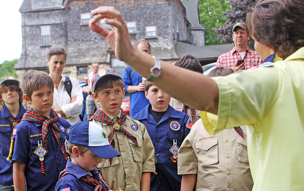 Jesse Poole/Gloucester Daily Times May 28, 2012 ESSEX— Members of the Essex Cub Scouts listen as Roxanne McGrath instructs them to not immediately collect bullet shells after rifles are fired at the Memorial Day ceremony on Monday morning at Memorial Park. To the boys' relief, she then explained that, after the ceremony, she could perhaps ask for some emptied shells to give to them.