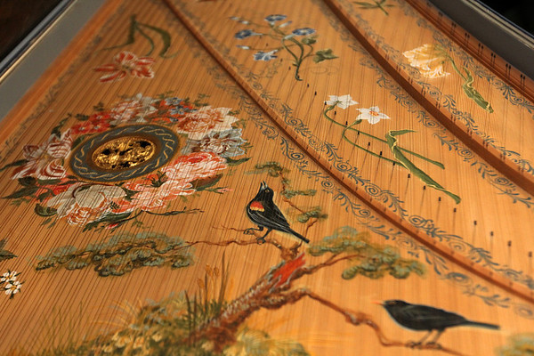 ALLEGRA BOVERMAN/Staff photo. Gloucester Daily Times. Gloucester: Detail of the harpsichord's spruce soundboard, hand painted by Carole Bolsey, depicting some of France Fitch's and Greg Bover's favorite flora and fauna.