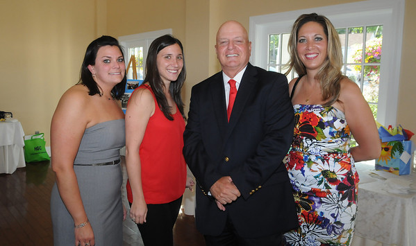 Gloucester:  Retiring Gloucester Interim Police Chief Michael Lane poses with his his girlfriend Dena Krukonis, on the right and his administrative aids Stacy Kouture and Heidi Fialho at a recieption dinner for him at the Cruiseport in Gloucester Wednesday night. JIm Vaiknoras/staff photo