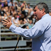 ALLEGRA BOVERMAN/Staff photo. Gloucester Daily Times. Gloucester: Retiring Gloucester High School Principal William Goodwin speaks to the entire school body during a surprise tribute in his honor at Newell Stadium on Thursday afternoon. In his extemporaneous remarks, he encouraged students to embrace every experience and never burn bridges, because you never know where your life will take you, it could take you right back around to where you began, in some cases, and he described the paths his own life took him, returning him to the school he attended to become its principal.