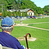 Jesse Poole/Gloucester Daily Times May 23, 2012 ESSEX— Dennis Henderson of Essex watches Manchester/Essex play Rockport in a Cape Ann League baseball game in Essex on Wednesday afternoon.