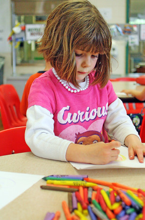 Kindergartener Lucy Fabian uses her rainy recess period to color at Essex Elementary School on Wednesday afternoon. Jesse Poole/Gloucester Daily Times May 9, 2012