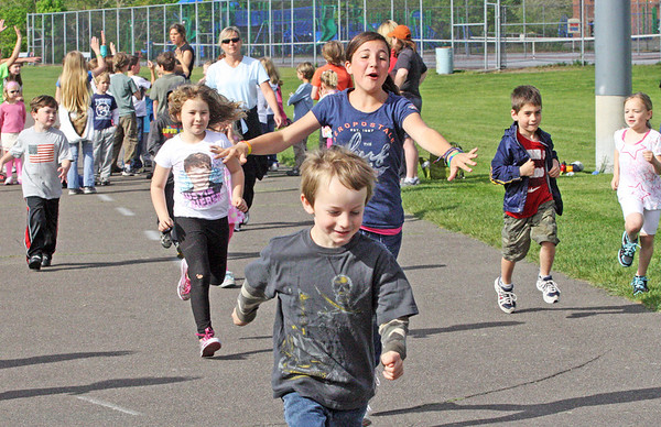 Jesse Poole/Gloucester Daily Times May 15, 2012 GLOUCESTER— Fifth-grader Abby Engel chases after a group of kindergarteners who were supposed to follow her lead in a one mile run during running club at Rockport Elementary School on Tuesday morning.