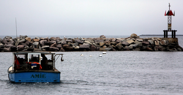 ALLEGRA BOVERMAN/Staff photo. Gloucester Daily Times. Rockport: A lobsterman heads back out from Rockport on Wednesday.