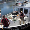 ALLEGRA BOVERMAN/Staff photo. Gloucester Daily Times. Rockport: Bill Lee, left, of Rockport, and Bob Smith, aboard the new Ocean Reporter. There will be a ceremony for the vessel on Friday, with Neptune presiding.