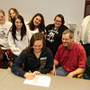 ALLEGRA BOVERMAN/Staff photo. Gloucester Daily Times. Gloucester: Audrey Knowlton, seated center, a Gloucester High School senior, signed her letter of intent to play basketball for New York Institute of Technology on Wednesday afternoon. Seated next to her, from left, are her sister Claire Knowlton, 12, and her parents Jim and Debbie Knowlton. Top row from left are: Joe Villante, freshman girls basketball coach, Audrey's sister Emma Knowlton, 14, seniors Alexandra Hanley, Claudia Oliva and Hanna Verga, GHS Principal William Goodwin. In back is girls varsity basketball coach Lori Sanborn.