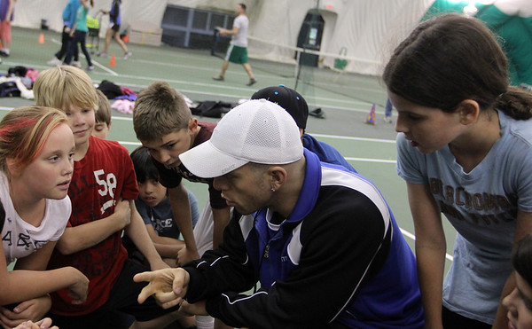 ALLEGRA BOVERMAN/Staff photo. Gloucester Daily Times. Manchester: West Parish Elementary School fifth graders from Gloucester  visited the Manchester Athletic Club on Tuesday to participate in a free enrichment program the center provides to the public about nutrition and sports. Students learned about eating more healthy foods and snacks, then played team-building games and drills that also can be played solo, so the kids can keep moving even when they're by themselves. The self-named Team Tebow confers with MAC trainer George Abele during the activities. The program has been in place for about six years and several area elementary and middle schools participate including Beeman Elementary, Plum Cove Elementary, St. Ann's and O'Maley Middle School, all of Gloucester.