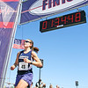 Jesse Poole/Gloucester Daily Times May 12, 2012 GLOUCESTER— Kimberly Mikesh, 31, of Charlestown, is the first woman to cross the finish line at Good Harbor Beach at one hour, 34 minutes and 25 seconds, putting her in thirtieth place in the Twin Lights Half Marathon on Saturday morning.