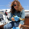 "ALLEGRA BOVERMAN/Staff photo. Gloucester Daily Times. Rockport: Emma Ouellette of Rockport varnishes the wood on a boat at Sandy Bay Yacht Club on Thursday afternoon in preparation for the season. She said working at the yacht club ""is the perfect summer job."""