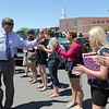 ALLEGRA BOVERMAN/Staff photo. Gloucester Daily Times. Gloucester: Retiring Gloucester High School Principal William Goodwin gets welcomed by the entire senior class on Thursday afternoon during a surprise tribute to him by the entire school population.