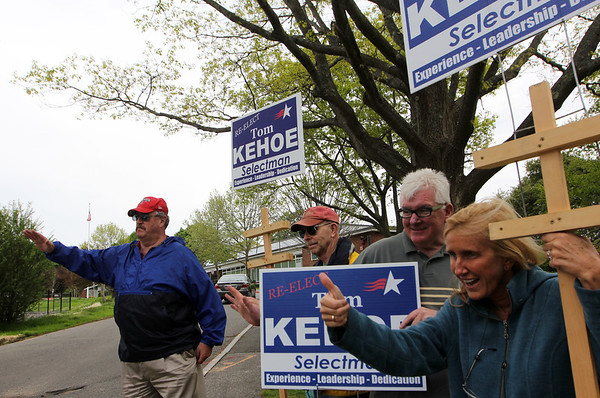 ALLEGRA BOVERMAN/Staff photo. Gloucester Daily Times. Manchester: Tom Kehoe, far left, and supporters during Manchester Election Day on Tuesday at Manchester Memorial Elementary School.  From left of Kehoe are: Jack Briggs, and Paul and Heidi Barclay.