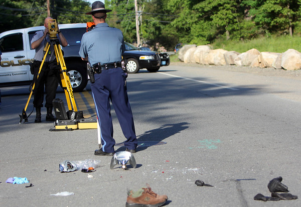 ALLEGRA BOVERMAN/Staff photo.Gloucester Daily Times. Gloucester: Massachusetts State Police and Gloucester Police reconstruct the scene of a fatal motorcycle and delivery truck accident at the intersection of Essex Avenue and Fernwood Lake Avenue late Thursday afternoon.