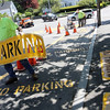 "ALLEGRA BOVERMAN/Staff photo. Gloucester Daily Times. Rockport: Bill Aspesi, Rockport highway foreman, lifts a stencil off a freshly painted ""no parking"" road marking along Main Street on Thursday afternoon. New lettering and lines are being painted all over town and started on Thursday."
