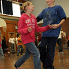 ALLEGRA BOVERMAN/Staff photo. Gloucester Daily Times. Gloucester: Veterans Memorial Elementary School fifth graders Sabrina Quince and Jacob Russell rehearse their ballroom dancing moves for the upcoming seventh annual Mad Hot Ball to be held on Sunday at the Gloucester High School Field House from 2-4:30 p.m. Three hundred fifth graders from across the school district will be participating and have been preparing for this for several months.