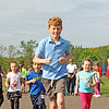 Jesse Poole/Gloucester Daily Times May 15, 2012 GLOUCESTER— Fifth-grader Will Andrews paces a group of joyful kindergarteners for a one mile run during running club at Rockport Elementary School. Many of these students are preparing for the upcoming Motif #1 Day 5K and 1 Mile Fun Run.