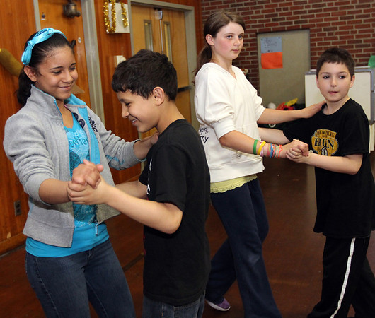 ALLEGRA BOVERMAN/Staff photo. Gloucester Daily Times. Gloucester: Veterans Memorial Elementary School fifth graders, from left: Julieka Rodrigues, Jose Rodrigues, Laine Ciaramitaro, Jeremy Wagner rehearse their ballroom dancing moves for the upcoming seventh annual Mad Hot Ball to be held on Sunday at the Gloucester High School Field House from 2-4:30 p.m. Three hundred fifth graders from across the school district will be participating and have been preparing for this for several months.