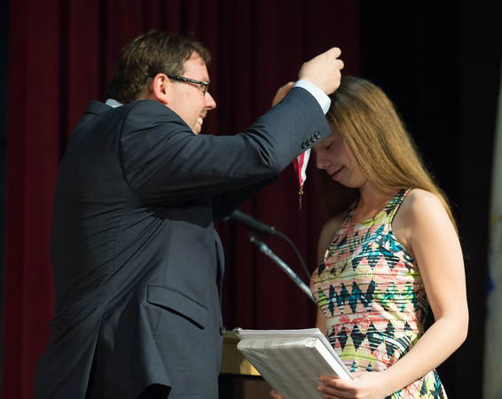 Desi Smith/Staff photo.  Samantha Orlando receives the Smith Book Award from math teacher David Dipietro Thursday night during the Gloucester High School Academic Recognition Night at the School.    May 26,2016