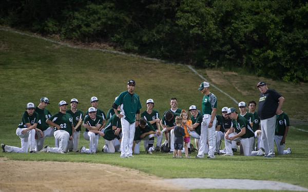 Desi Smith/Staff photo.       Manchester Essex sadly looks over at Hamilton-Wenham, as they are awarded the first place plaque after the Cape Ann Savings Bank Memorial Day Baseball Classic Tournament Finals held Saturday night at Evans Field in Rockport.