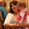 Gloucester: At the Annual Crowning Feast of the Holy Spirit held at Our Lady of Good Voyage Parish on Sun., May 15, 2016. Bart and Mary Piscitello were honored this year with the Crown and they and their family were crowned first at the end of the Mass. Jennifer Strangman, their daughter, who was also crowned, holds her grandson, Kayden Babine, 1 1/2 as they watch the crowning of other parish  members. Photo by Allegra Boverman