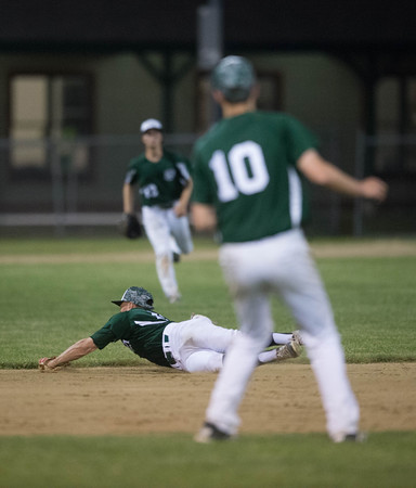 Desi Smith/Staff photo.       Manchester Essex's Hunter Flood (12) makes a diving catch on a line drive against Hamilton-Wenham during the Cape Ann Savings Bank Memorial Day Baseball Classic Tournament Finals held Saturday night at Evans Field in Rockport. The Hornets lost 3-2