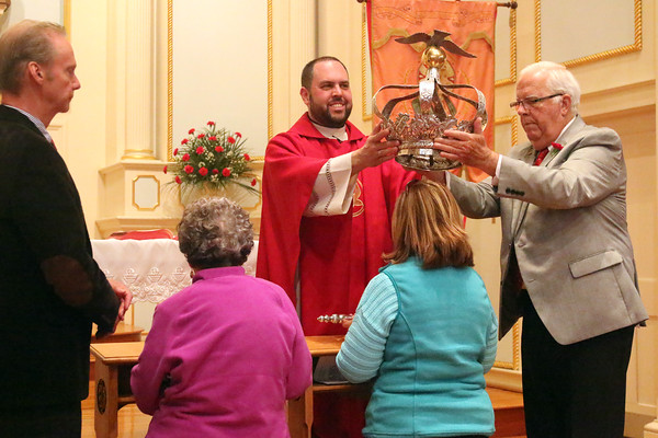 Gloucester: At the Annual Crowning Feast of the Holy Spirit held at Our Lady of Good Voyage Parish on Sun., May 15, 2016. Bart and Mary Piscitello were honored this year with the Crown and they and their family were crowned first at the end of the Mass. <br /> Father Jim Achadinha, standing, center, presides over the ceremony, helped by Mark Davis, left, and David Rose, right.  Kneeling, from left, are Alice Schmidt and Carla Grillo. <br /> Photo by Allegra Boverman