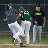 Desi Smith/Staff photo.       Manchester Essex's Charlie Otterbein (23) crashes into Hamilton-Wenham's first baseman (not on roster) during the Cape Ann Savings Bank Memorial Day Baseball Classic Tournament Finals held Saturday night at Evans Field in Rockport. The Hornets lost 3-2
