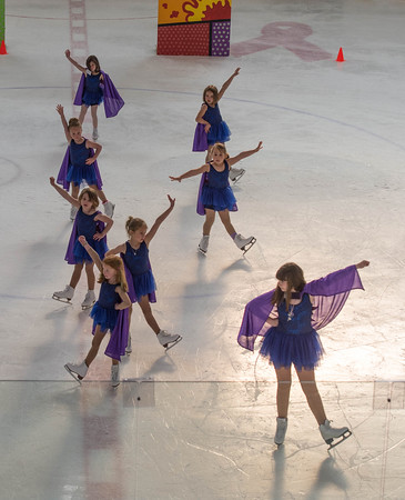 """Desi Smith/Staff photo.   Faith Ellis, Maggie Routt, Ella Glover, Molly Degnan, Naia Gibson, Madison Jewell, Delilah Parisi and Janelle Brancaleone perform """"Get Your Cape On"""" by DC Super Hero Girls during a dress rehearsal for the Annual Cape Ann Figure Skating Club. Show is this Saturday 5/14 2pm at O'Maley School.  Tickets $10 at the door. Kids under 5 free. $8 in advance. More info Cafsc.org.    May 12,2016"""