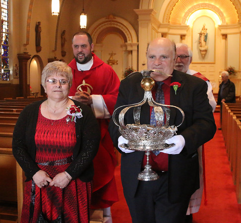 Gloucester: At the Annual Crowning Feast of the Holy Spirit held at Our Lady of Good Voyage Parish on Sun., May 15, 2016. Bart and Mary Piscitello were honored this year with the Crown and they and their family were crowned first at the end of the Mass.  With them are Father Jim Achadinha, back left, and Deacon Ray Wellbank as they proceed out of the church at the conclusion of Mass and the Crowning. Photo by Allegra Boverman