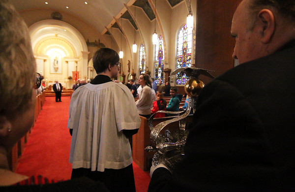 Gloucester: At the Annual Crowning Feast of the Holy Spirit held at Our Lady of Good Voyage Parish on Sun., May 15, 2016. Bart and Mary Piscitello were honored this year with the Crown and they and their family were crowned first at the end of the Mass.  They get ready to walk carefully into the church with the Crown before Mass began. Photo by Allegra Boverman