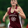 DAVID LE/Staff photo. Gloucester's Maura McCormick cruised to a victory in the girls two-mile race against Marblehead in a battle to determine the NEC champions. 5/24/16.