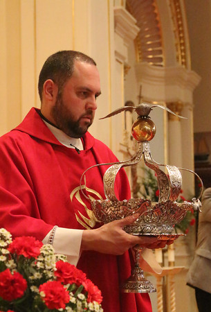 Gloucester: At the Annual Crowning Feast of the Holy Spirit held at Our Lady of Good Voyage Parish on Sun., May 15, 2016. Bart and Mary Piscitello were honored this year with the Crown and they and their family were crowned first at the end of the Mass.  Father Jim Achadinha holds the Crown. Photo by Allegra Boverman