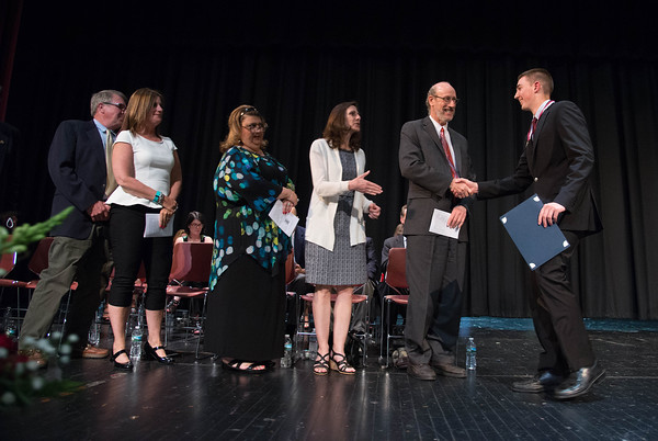 Desi Smith/Staff photo.  Owen Brown is congratulated by Dr.Richard Safier and others Thursday night at after receiving the Sons of the American Revolution Citizenship Award during the Gloucester High School Academic Recognition Night at the School.    May 26,2016