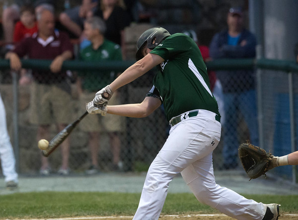 Desi Smith/Staff photo.       Manchester Essex's Brandon Bartlett (17) connects with nthe ball for a hit against Hamilton-Wenham during the Cape Ann Savings Bank Memorial Day Baseball Classic Tournament Finals held Saturday night at Evans Field in Rockport. The Hornets lost 3-2