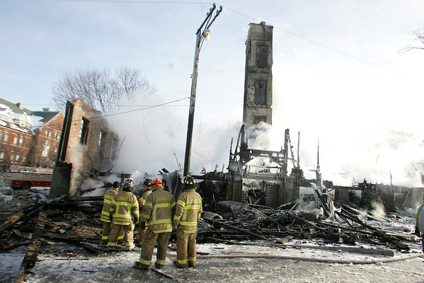 Gloucester:  Firefighters keep fire on the hot spots of the Lorraine Apartments that burned down early Saturday morning.Photo by Mary Muckenhoupt/Gloucester Daily Times. Sunday, December 16, 2007