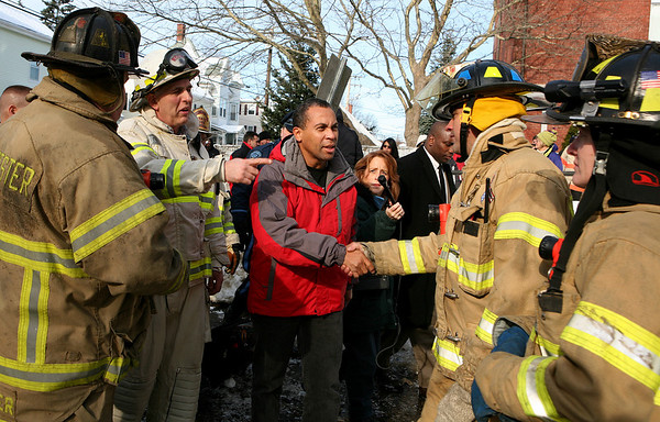 Gloucester: Chief Barry McKay, second from left, introduces Governor Deval Patrick to some of the firefighters who worked through the night to put out a fire that destroyed an apartment building and a temple on Middle Street. Photo by Amy Sweeney Gloucester Daily Times. Saturday, December 15, 2007