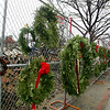 Gloucester: Wreaths hang on the fence surrounding the scene of the Middle Street Fire that took place December 14 and 15.  Officials have closed the fire investigation and have determined that the fire was accidental.  A specific cause was never determined because of the total destruction of the sight. <br /> Photo by Mary Muckenhoupt/Gloucester Daily Times Friday, January 11, 2008