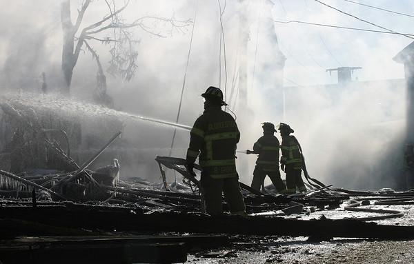 Gloucester: Firefighter hoses down the hot spots at the scene of a fire on Middle Street, which claimed one life.Photo by Amy Sweeney Gloucester Daily Times. Saturday, December 15, 2007